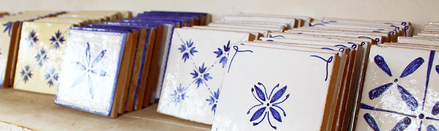 Hand painted terracotta wall tiles